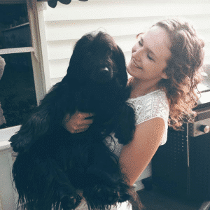 genki pet healthier happier pets and their people woman holding black dog smiling