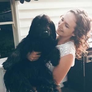 baus canine bowen woman holding dog pet health