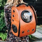 Genki Pet Aromatherapy for pets and their people cat going on holidays in orange backpack
