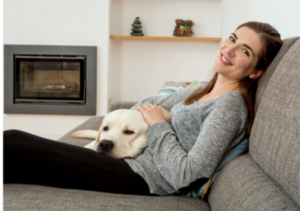 lady and labrador dog relaxing on couch calm anxiety free