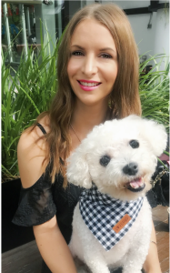 Happy and healthy relaxed smiling woman with her cute fluffy white calm dog