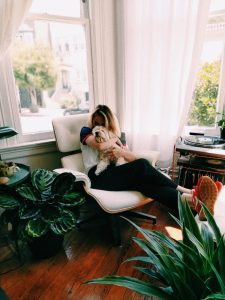 woman and dog healthy and happy with plants at home