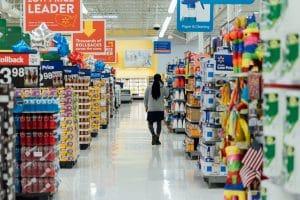 man in supermarket aisle